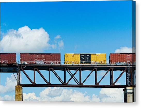 Freight Trains Canvas Print - Freight Train Passing Over A Bridge by Panoramic Images