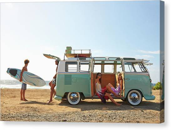 Friends With Van Relaxing On Beach Canvas Print by Colin Anderson Productions Pty Ltd