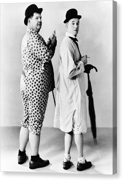 Nightshirts Canvas Print - From Left Oliver Hardy, Stan Laurel by Everett