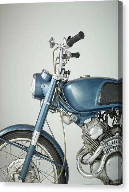 Front Of Vintage Motorcycle In Studio Canvas Print by Nisian Hughes