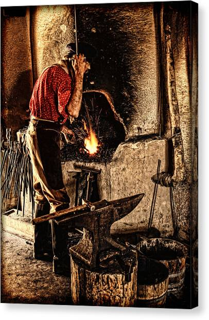 Frontier Blacksmith At The Forge Canvas Print