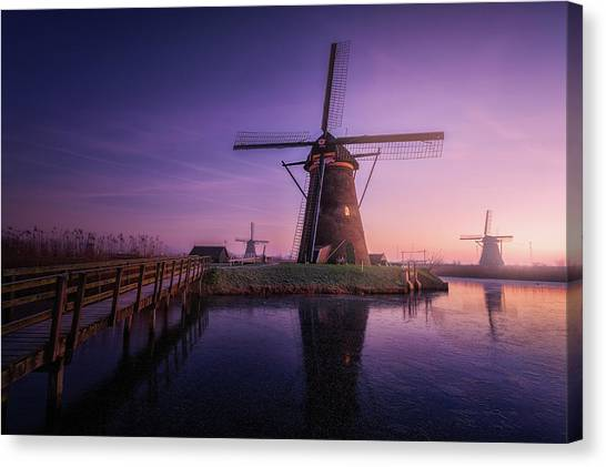 Holland Canvas Print - Frozen Kinderdijk by Clara Gamito
