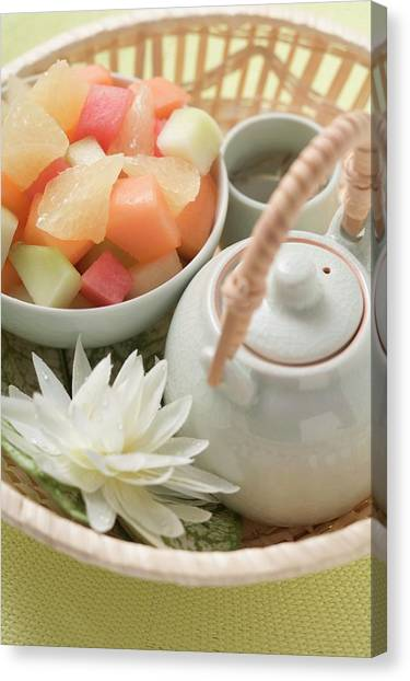 Sweet Tea Canvas Print - Fruit Salad And Tea In Basket by Foodcollection