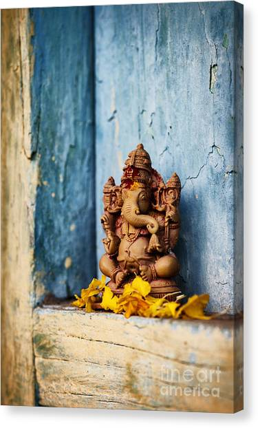 Hinduism Canvas Print - Ganesha Statue And Flower Petals by Tim Gainey