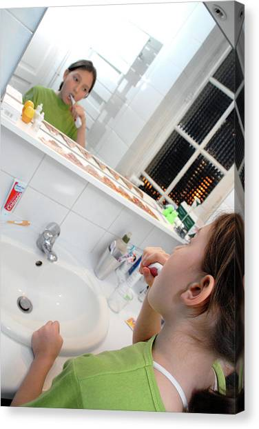 Toothbrush Canvas Print - Girl Brushing Her Teeth by Aj Photo/science Photo Library