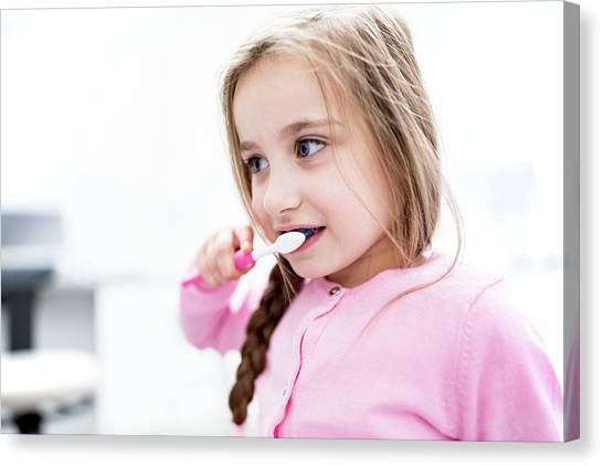 Toothbrush Canvas Print - Girl Brushing Teeth by Science Photo Library