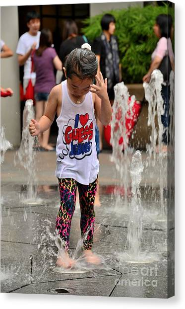 Girl Child Plays With Water At Fountain Singapore Canvas Print