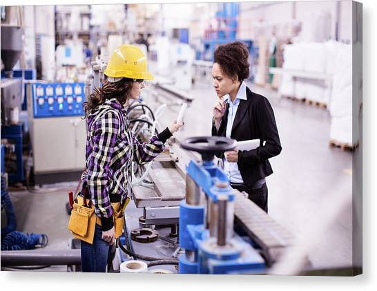 Girl In A Factory Working With Her Woman Boss Canvas Print by Milanvirijevic