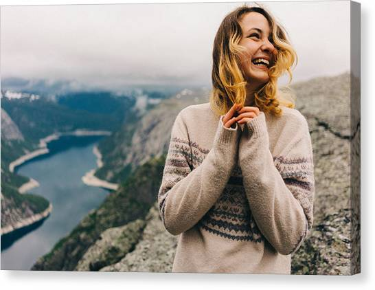 Girl Laughing On The Trolltunga Canvas Print by Oleh_Slobodeniuk