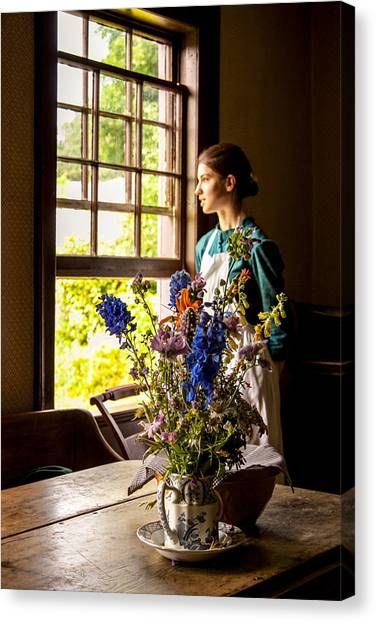 Girl Looking Through An Open Window  Canvas Print