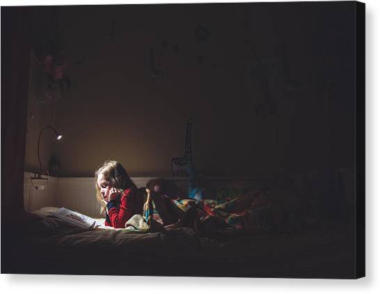 Girl Reading In Her Bed At Night Canvas Print by Teresa Short