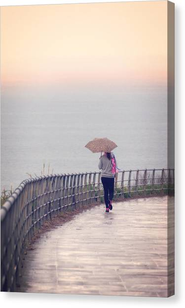 Girl Walking With Umbrella Canvas Print