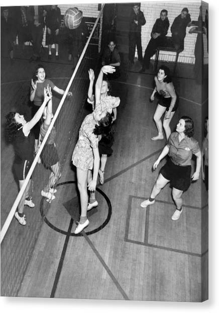 Volleyball Canvas Print - Girls Playing Volleyball by Underwood Archives