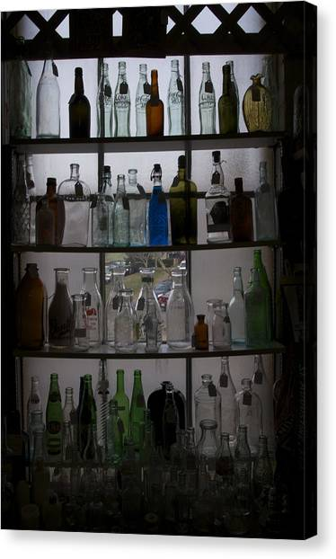 Glass Bottles Canvas Print by Micaela Brown