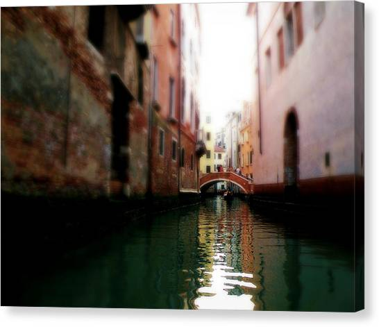 Gliding Along The Canal  Canvas Print