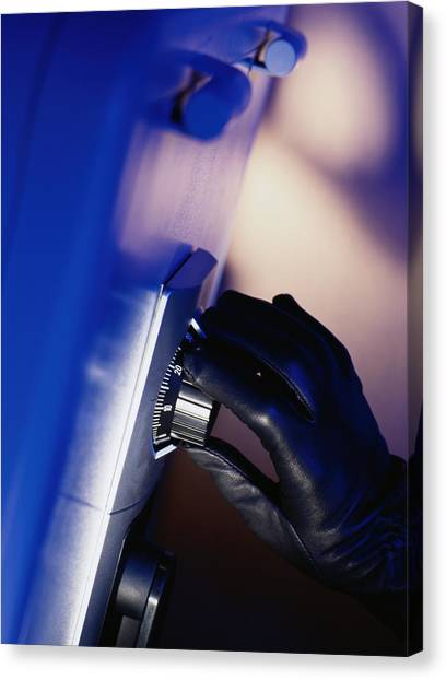 Gloved Hand Opening A Safe Canvas Print by Photodisc