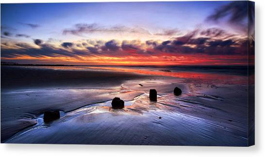Glyne Gap Sunrise Canvas Print by Mark Leader