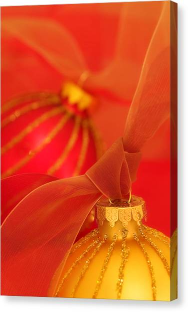 Soft Focus Canvas Print - Gold And Red Ornaments With Ribbons by Carol Leigh