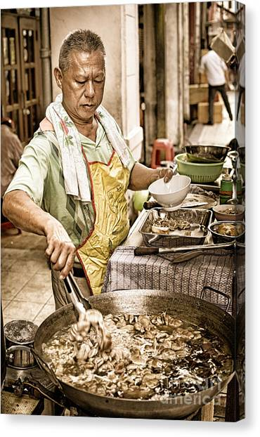 Golden Glow - South East Asian Street Vendor Cooking Food At His Stall Canvas Print