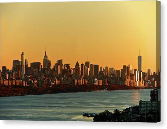 Golden Sunset On Nyc Skyline Canvas Print by Robert D. Barnes