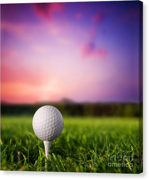 Golf Course Canvas Print - Golf Ball On Tee At Sunset by Michal Bednarek