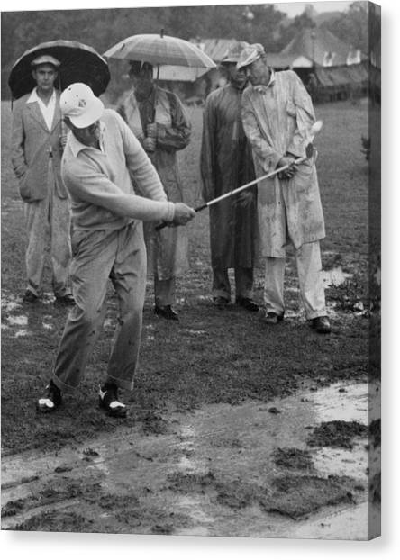 Golf equipment canvas print golfer playing in the rain by underwood archives