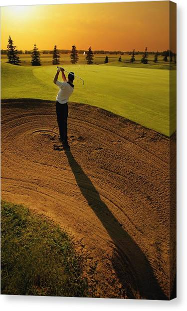 Golf Course Canvas Print - Golfer Taking A Swing From A Golf Bunker by Darren Greenwood
