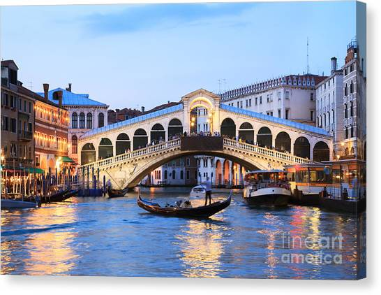 City Sunsets Canvas Print - Gondola In Front Of Rialto Bridge At Dusk Venice Italy by Matteo Colombo