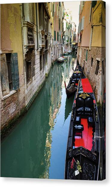Gondolas And Canal, Venice, Veneto Canvas Print by Russ Bishop