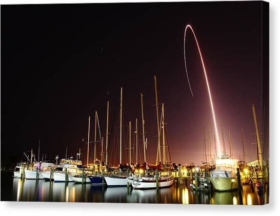Gps Launch Over The Marina Canvas Print by John Moss