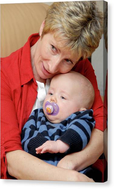 Grandmother And Baby Canvas Print by Aj Photo/science Photo Library