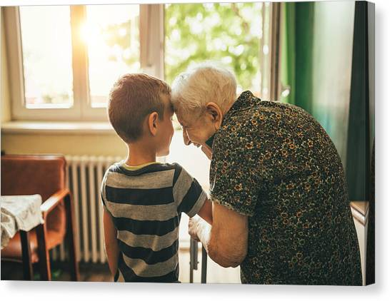 Grandson Visiting His Granny In Nursery Canvas Print by Supersizer