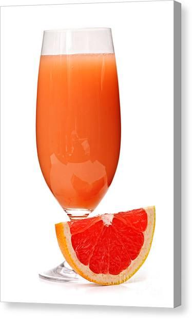 Juice Canvas Print - Grapefruit Juice In Glass by Elena Elisseeva