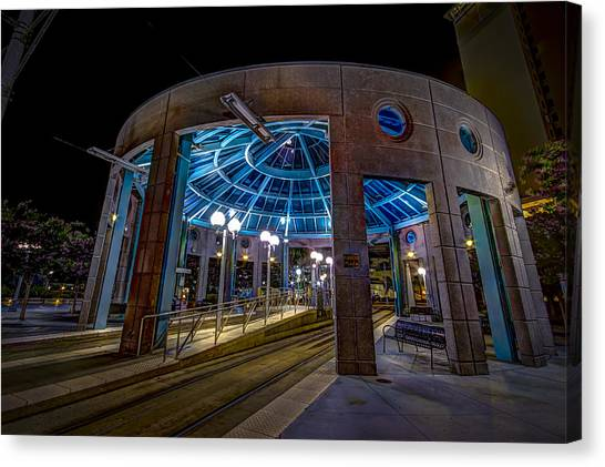 Light Rail Canvas Print - Greco Plaza by Marvin Spates