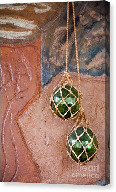 Binders Canvas Print - Two Green Glass Balls Dangle On The Wall  by Arletta Cwalina