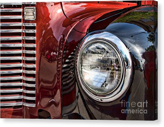 Grill And Headlamp Canvas Print by Lawrence Burry