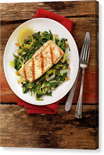 Grilled Halibut With Spinach, Leeks And Canvas Print by Lauripatterson