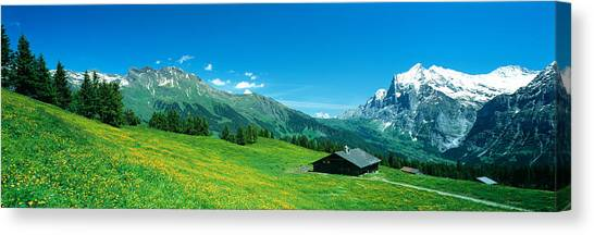 Old Houses Canvas Print - Grindelwald Switzerland by Panoramic Images