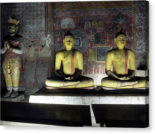 Golden Temple Canvas Print - Group Of Buddha Statues In Cave IIi by Panoramic Images