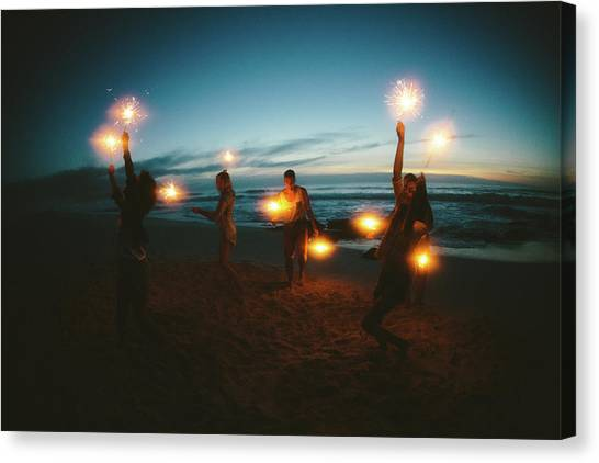 Group Of Friends With Fireworks Canvas Print by Wundervisuals