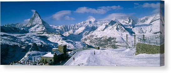 Matterhorn Canvas Print - Group Of People Skiing Near A Mountain by Panoramic Images
