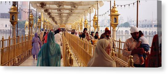 Golden Temple Canvas Print - Group Of People Walking On A Bridge by Panoramic Images