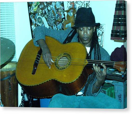 Gully Guitar And Black Hat  Canvas Print by Cleaster Cotton