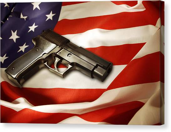 Gun Control Canvas Print - Gun On Flag by Les Cunliffe