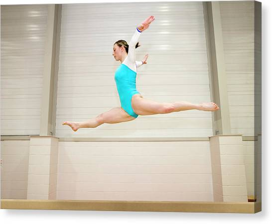 Balance Beam Canvas Print - Gymnast Jumping On A Balance Beam by Gustoimages/science Photo Library