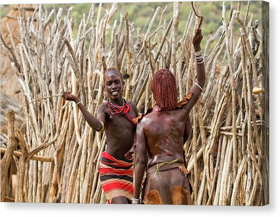 Ethiopian Woman Canvas Print - Hamer Man With Reed Whip by Photostock-israel