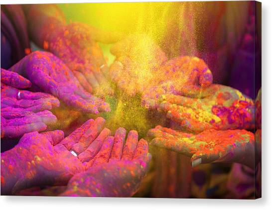 Hands And Colorful Powders Of The Holi Festival Canvas Print by Mammuth