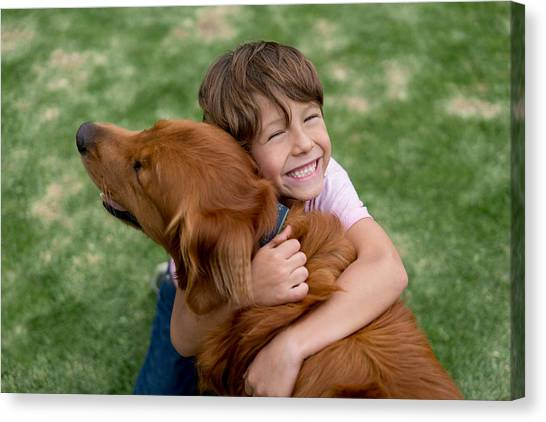 Happy Boy With A Beautiful Dog Canvas Print by Andresr