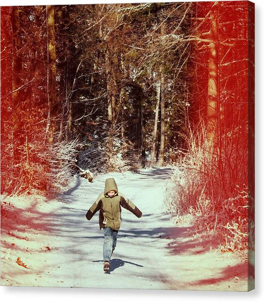 Snow Canvas Print - Happy Young Boy Running In The Winterly Forest by Matthias Hauser