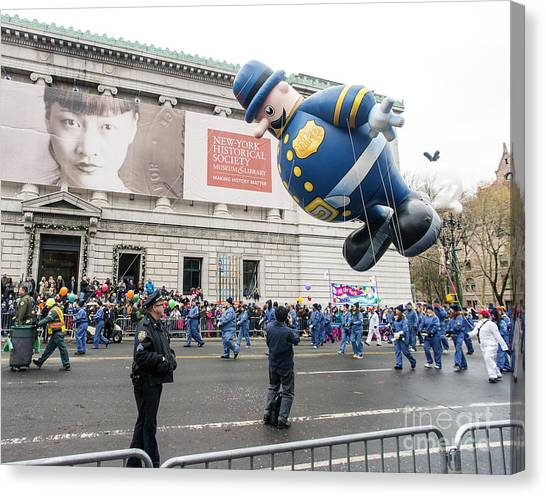 Macys Parade Canvas Print - Harold The Policeman Balloon At Macy's Thanksgiving Day Parade by David Oppenheimer
